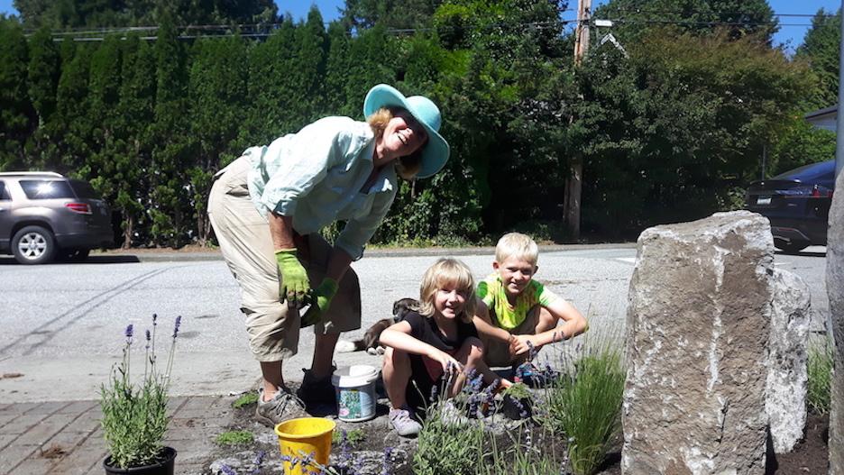 children planting pollinators